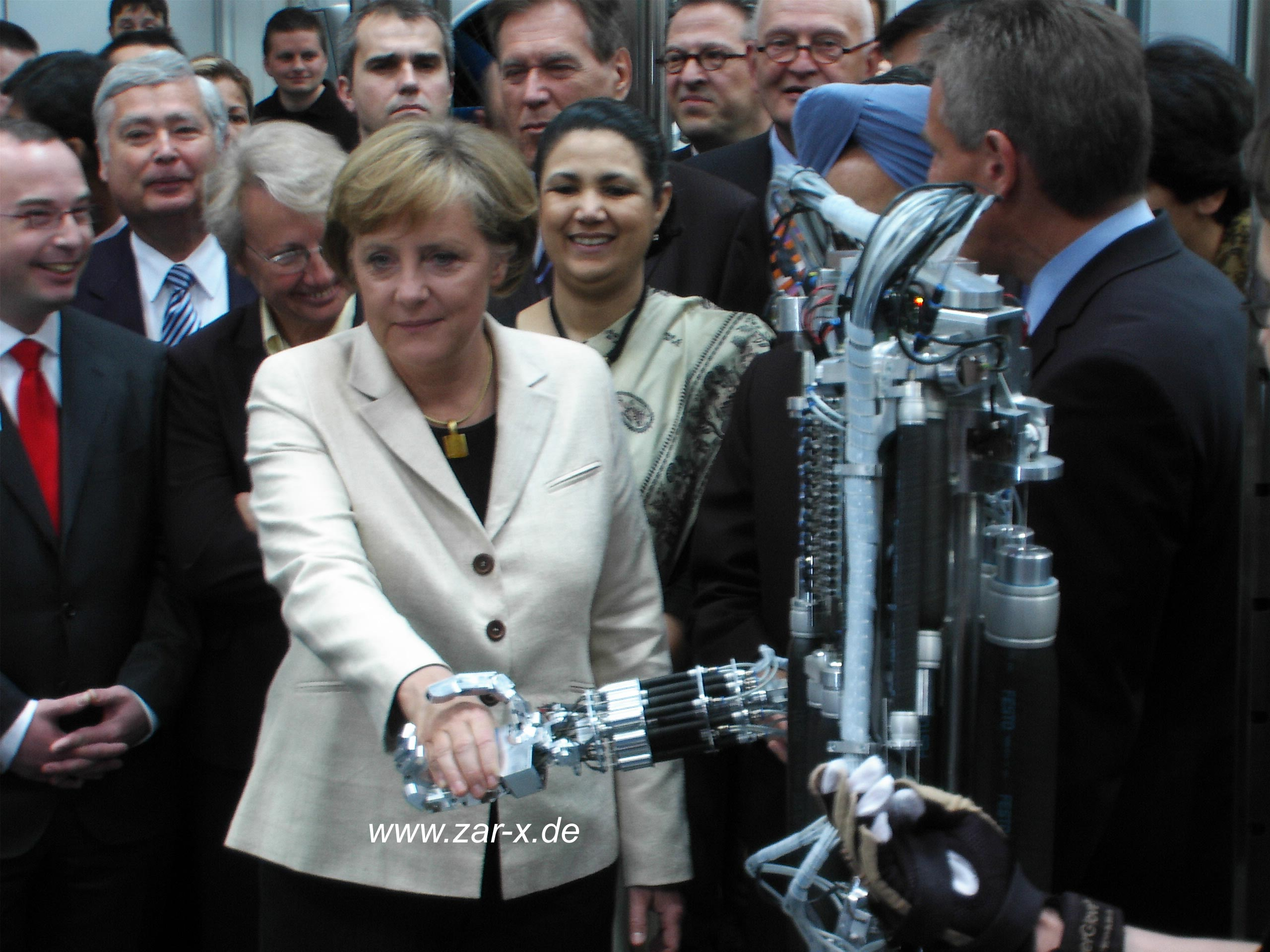 """Chancellor Dr. Angela Merkel shakes the hand of ZAR5, 2006."""
